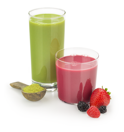 green and red beverages in glasses with scoop of protein powder and berries