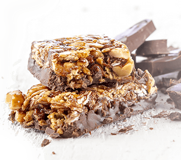 nut bars with chocolate in the background